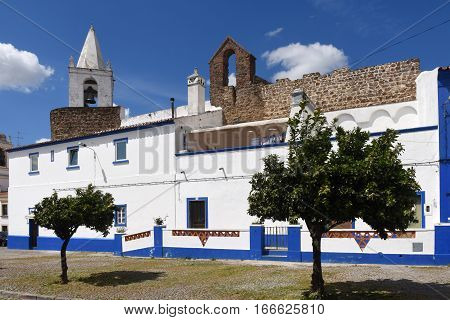 Houses in front of the castle walls and church the village of Redondo Alentejo region Portugal
