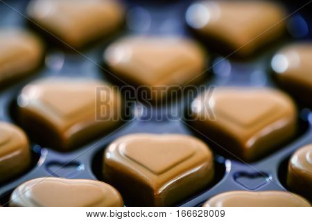Closeup of heart shaped pralines in a box for valentines day