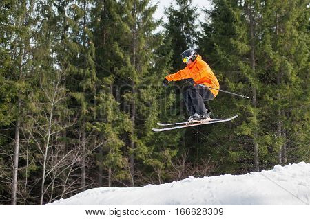 Flying Skier Man At Jump From The Slope Of Mountains