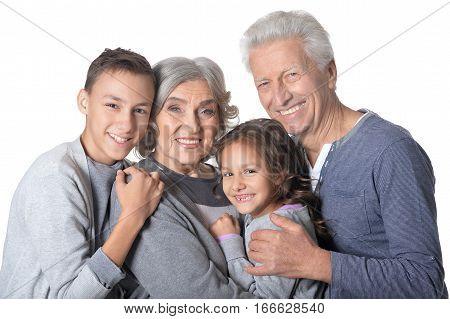 Portrait of a grandparents with grandchildren, against white