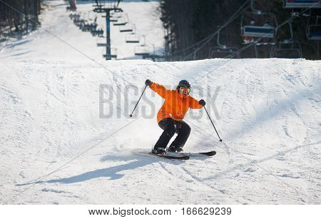 Skier Skiing Downhill In The Moment Of Falling