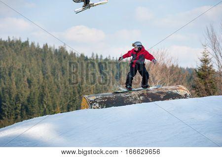 Male Boarder Slides Down Over A Hurdle