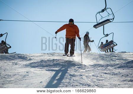 Man Skier Skiing Downhill At Ski Resort
