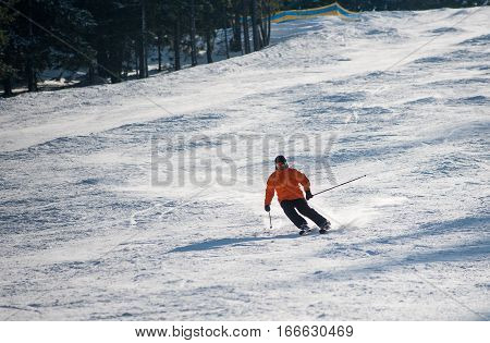 Man Skier Skiing Downhill At Ski Resort