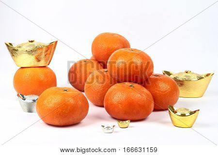 Golden Orange With Silver And Gold Of Silver Ingots .