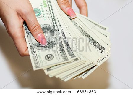 The Money Is In Women's Hand. Hand With Money, Banknotes In Hand, Counting Banknotes