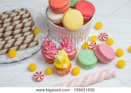 Wedding Candy Bar - Colorful Cupcakes, Macaroons And Candy