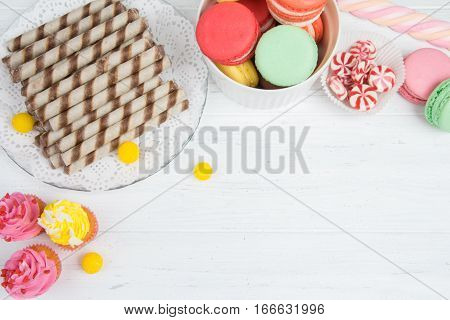 Set Of Sweets, Cupcakes, Macaroons, Wafer Rolls And Other Sweets