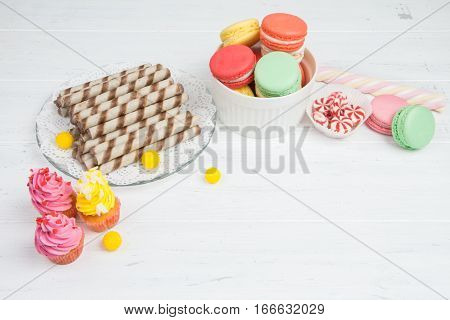 Colourful Sweets For Candy Bar On White Wooden Table