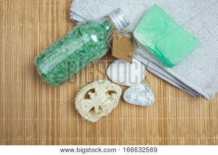 Soap, Bath Salt, Stones And Towel On Bamboo. Spa Background