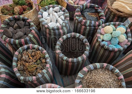 Souvenirs: pumice tea cinnamon bast wisp and other in striped sacks. Over view.