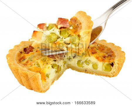 Savoury pea and pancetta tarts isolated on a white background