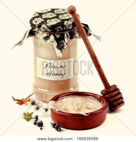 Arrangement of Flower Honey in Glass Jar Honey Dipper and Bowl with Honey closeup on White background. Retro Styled