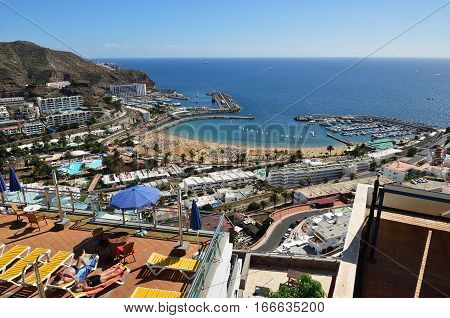 PUERTO RICO SPAIN - FEB 19 2014: View on of Puerto Rico resorts Gran Canaria. It is of main resort of island with public beach shopping facilities and restaurants.The most popular tourist destination all the year