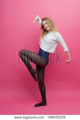 one girl blonde dancing on a pink background
