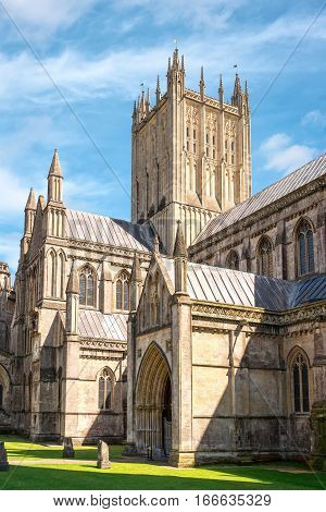 Central tower of Cathedral Church of Saint Andrew commonly known as Wells Cathedral on a summer sunny day.