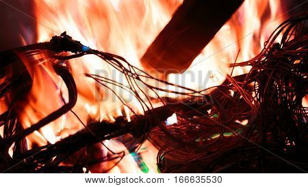 wires on fire. Firing winding insulation of electrical wiring in the fire close-up