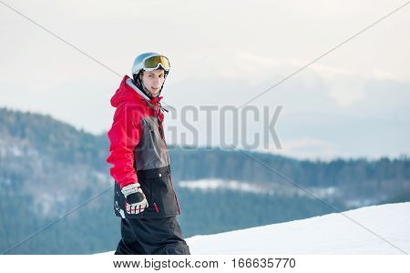 Male Boarder On His Snowboard At Winer Resort