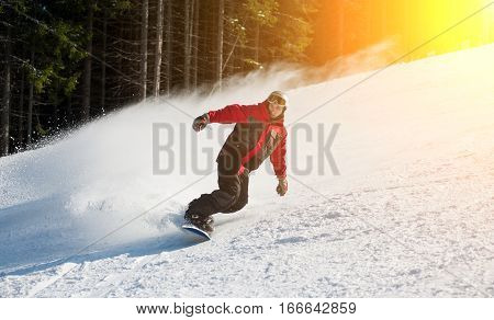 Man Snowboarder Slides Down From The Mountain In Winter Day