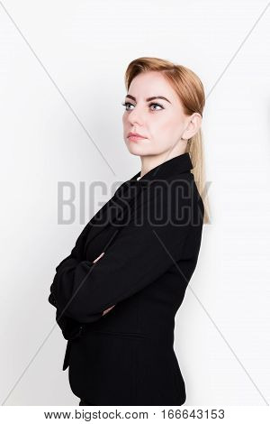 Attractive and energetic business woman in a suit on a naked body.