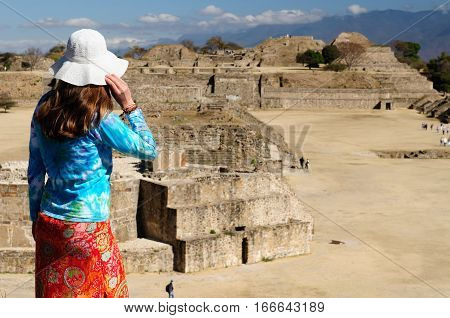 Tourist travelling all over Mexico visiting ruins of the ancient city Monte Alban near Oaxaca city Mexico