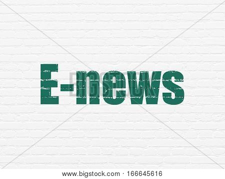 News concept: Painted green text E-news on White Brick wall background
