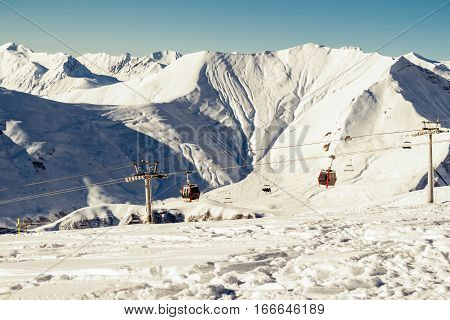 Photo of the Ski lift gondola with amazing mountain on background. Extreme sport. Active holiday. Free time, travel concept. Copy space