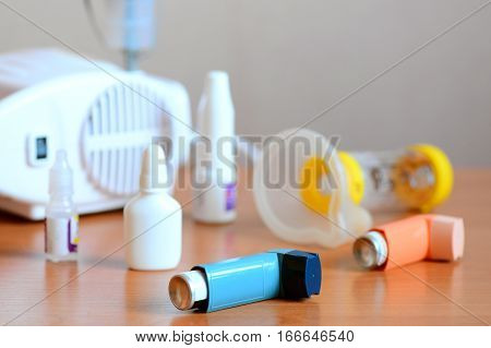 Medical equipment and drugs for treatment of asthma. Nebulizer, inhaler, spacer, nebula, anti-inflammatory drugs to manage asthma. Bronchi asthma, allergy concept