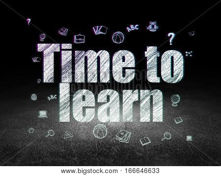 Studying concept: Glowing text Time to Learn,  Hand Drawn Education Icons in grunge dark room with Dirty Floor, black background