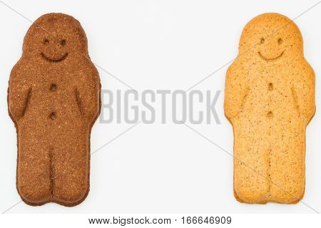 Two happy and smiling, black and white gingerbread men on an isolated background with copy space representing racial harmony, diversity and equality.