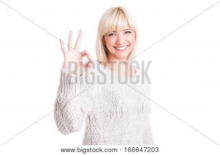 Pretty Woman Wearing Warm Sweter Showing Okay Gesture