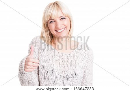 Pretty Woman Wearing Warm Sweter Showing Like Gesture