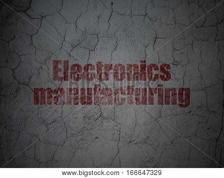 Industry concept: Red Electronics Manufacturing on grunge textured concrete wall background