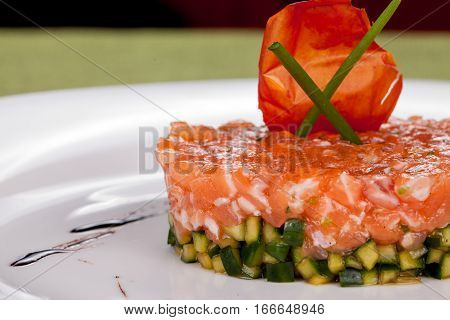 appetizer of salmon and cucumber close up