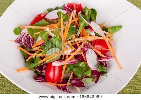 fresh vegetable salad with radish and cherry close up