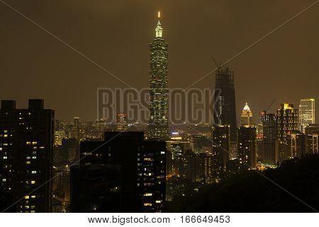 TAIPEI TAIWAN - NOVEMBER 21 2016: Taipei 101 building is a famous landmark was taken at sunset from elephant mountain