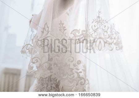 Beautiful white wedding dress. Unrecognizable close-up interior