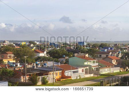 Cassino beach homes with Rio Grande port in background