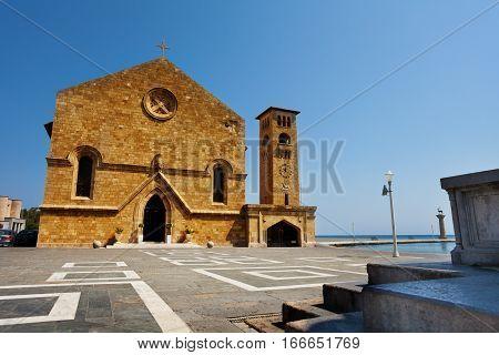 The fortress of St. Nicholas at Mandraki Harbor at sunny day, Greece
