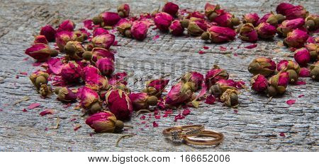 Heart Made Of Dried Flowers, Buds Of Roses And Two Gold Rings