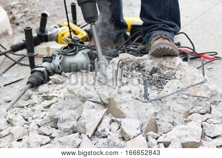 Drilling hole into concrete,drill on the concrete background