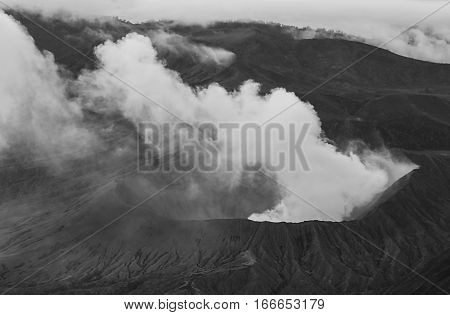 Artistic black and white volcano erupting landscape