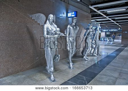New Delhi India - Jule 20 2011: Sculpture passengers in international Airport of Delhi. Indira Gandhi International Airport is the 32th busiest in the world.