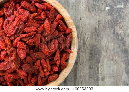 Wolfberries or Goji berries in bowl on wooden table