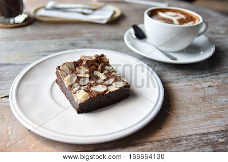 Toffee cake with tea coffee on wood table