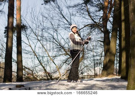 A Girl Cross-country Skiing In A Snowy Forest