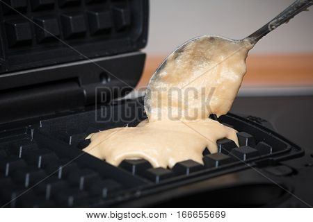 homemade waffles. Waffle dough ready to be poured onto the waffle iron
