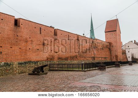 RIGA LATVIA - 2ND JAN 2017: The outside of walls near the Latvian War Museum in Riga. An old canon can be seen.