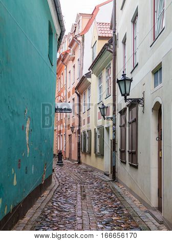 RIGA LATVIA - 2ND JAN 2017: A view along Torna Iela in Riga during the day showing the outside of shops and restaurants.