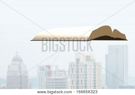 Book Flying Over City